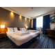Twin bedded room with special layout for an extra large bed