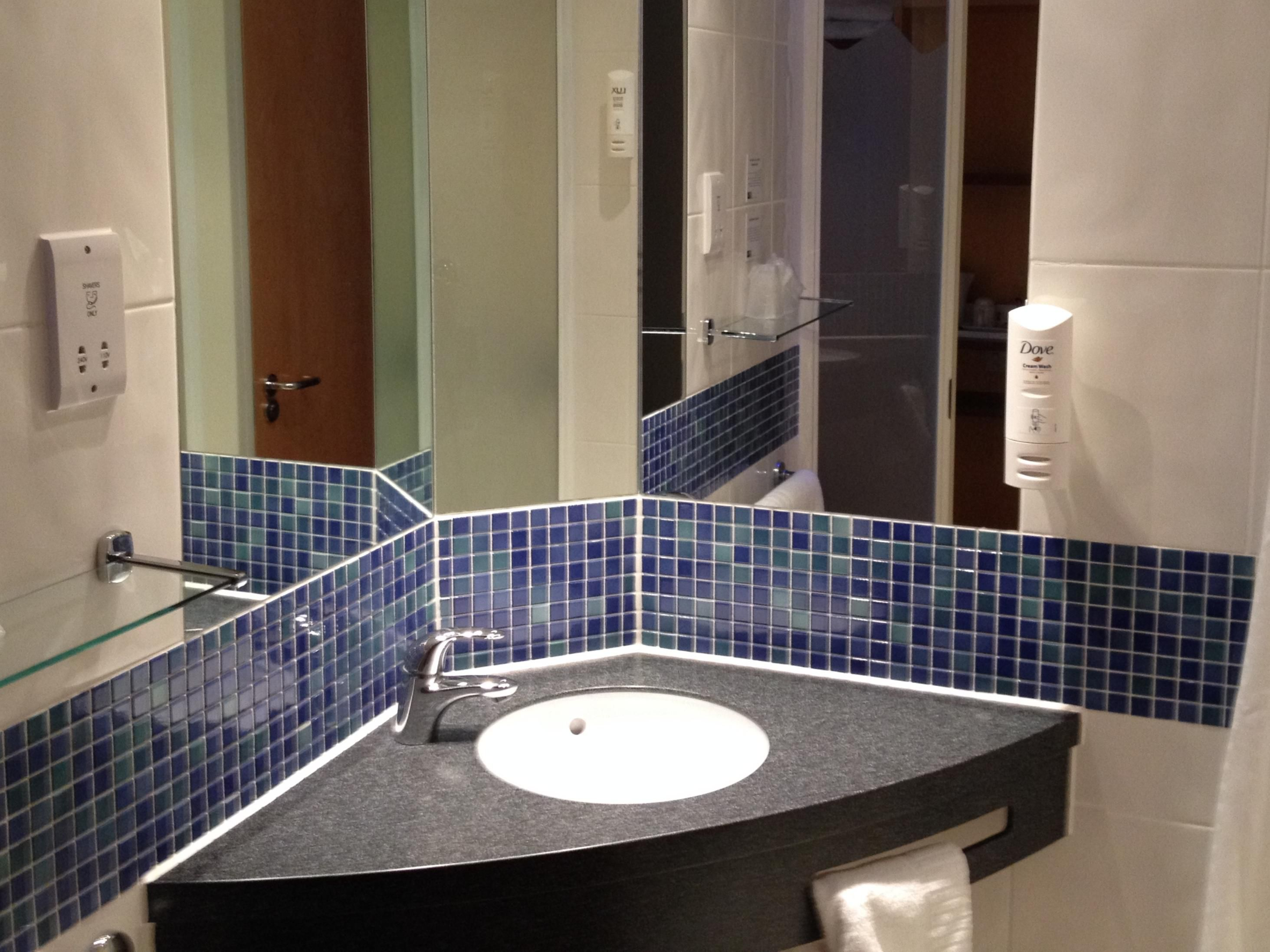 A guest bathroom featuring the sink area