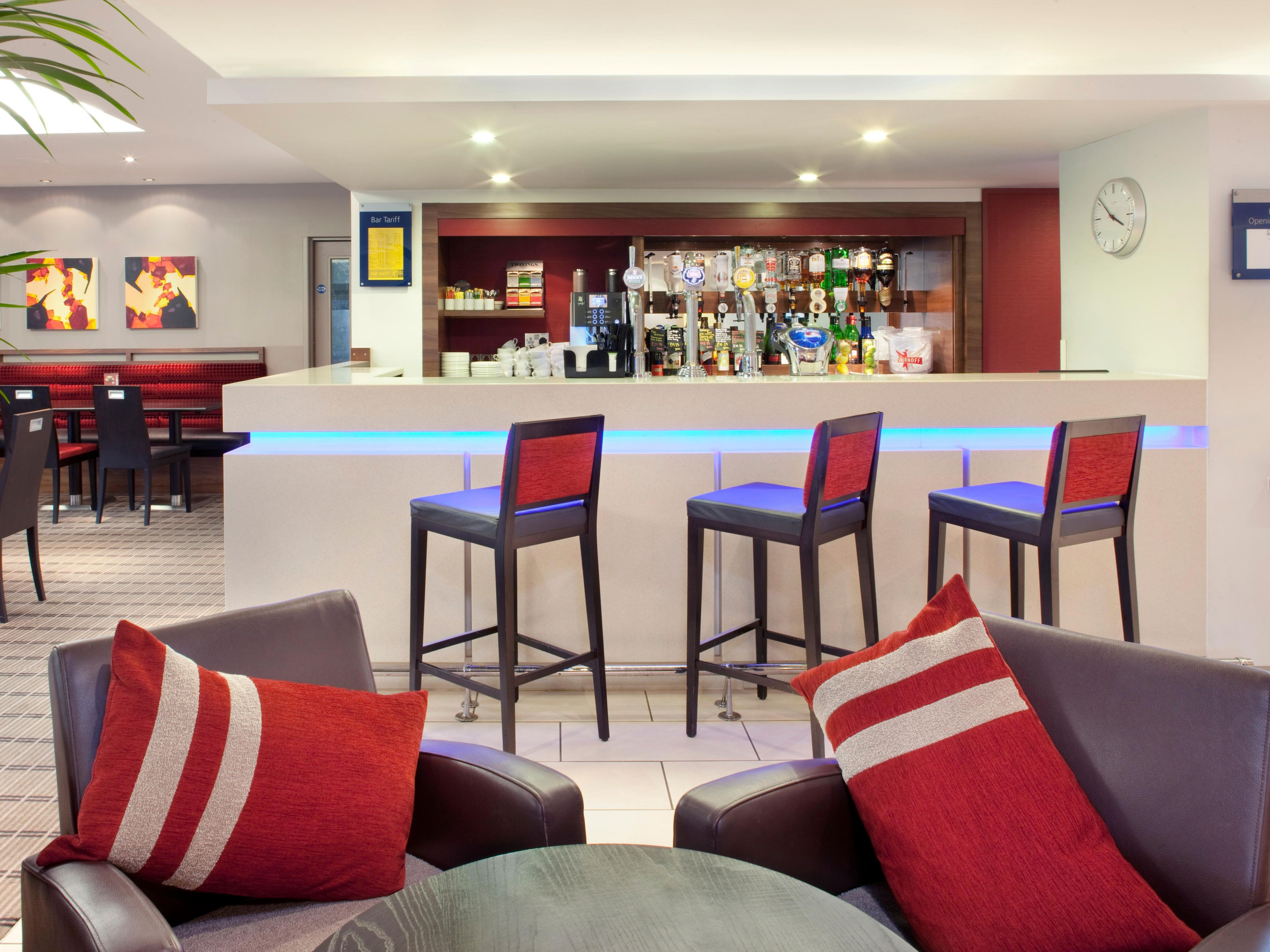 Order drinks at the bar at Holiday Inn Express hotel in Warwick