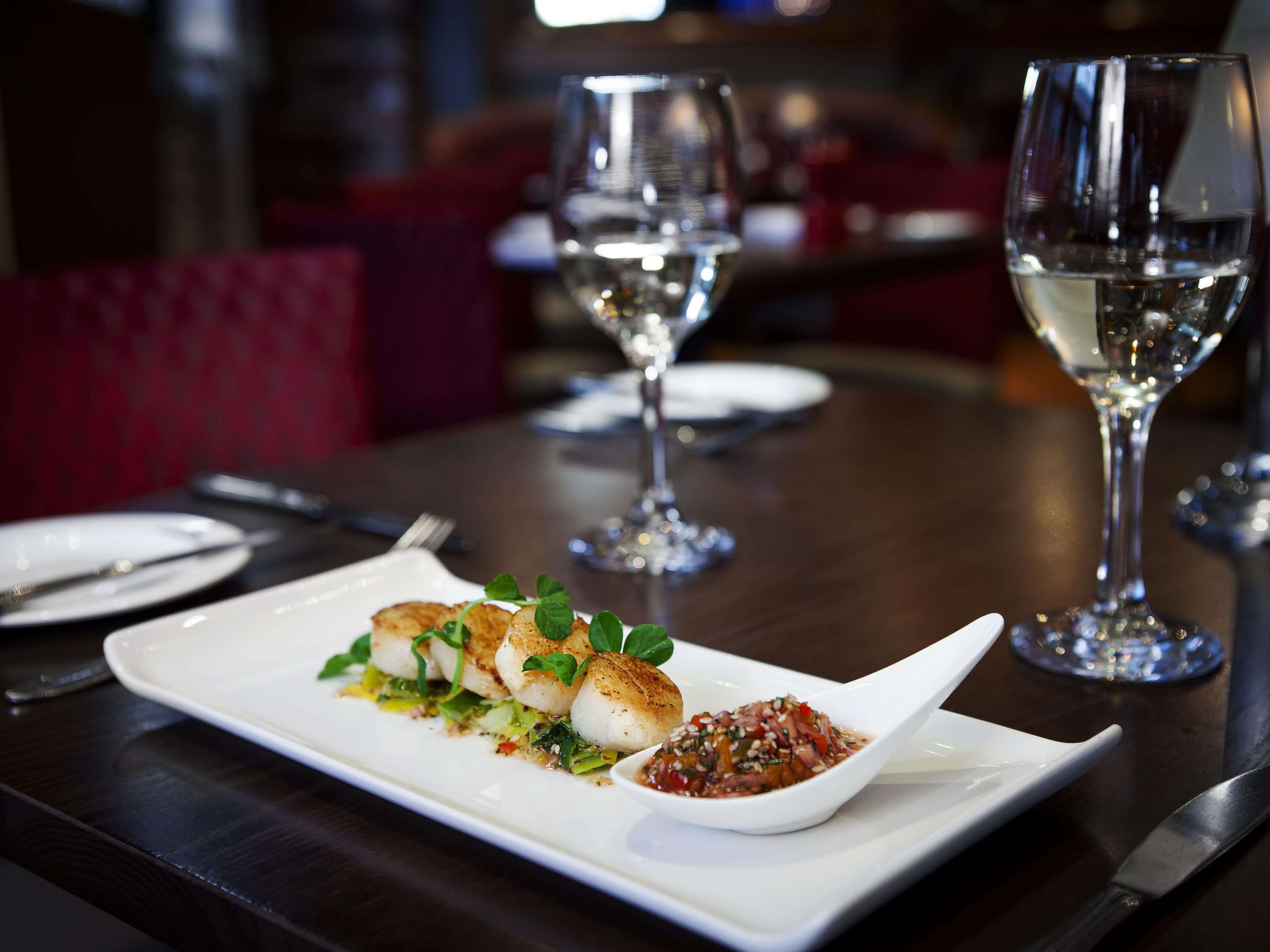 Locally sourced scallops with wine from our extensive wine list