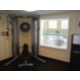 Gym includes medicine balls, dumbbells, yoga mat, and elliptical.