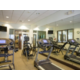 Refreshed fitness room with cardio and strength equipment