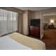 Queen Deluxe Suite Bedroom Area