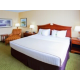 King guest room with lounge chair and 32' LCD TV