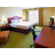 King guest room with triple sheeting and 32' LCD TV