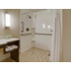 This suite offers a roll-in shower for full ADA accessibility.