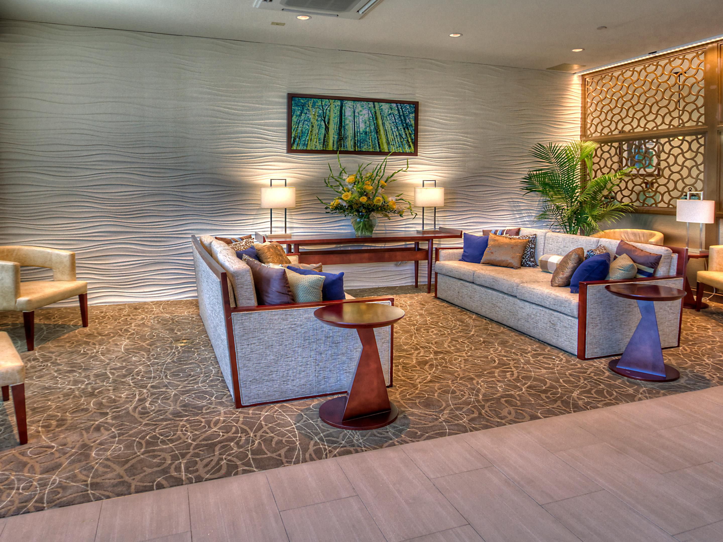 Relax in our front lobby, one of the many lounge areas we offer