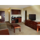Large living kitchen area in our suites