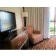 Separate Bedroom with Comfy Chair in Suite