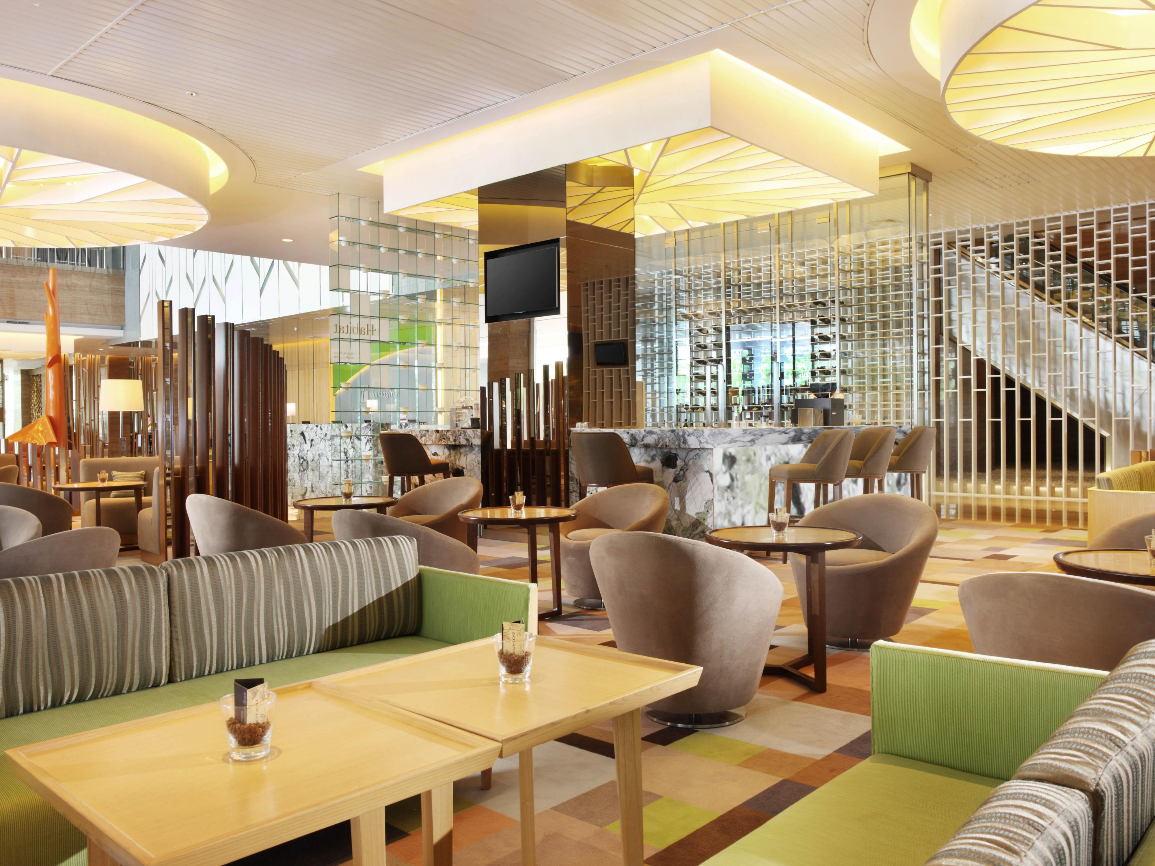 Indulge with your favorite cocktail at Habitat Lobby Lounge