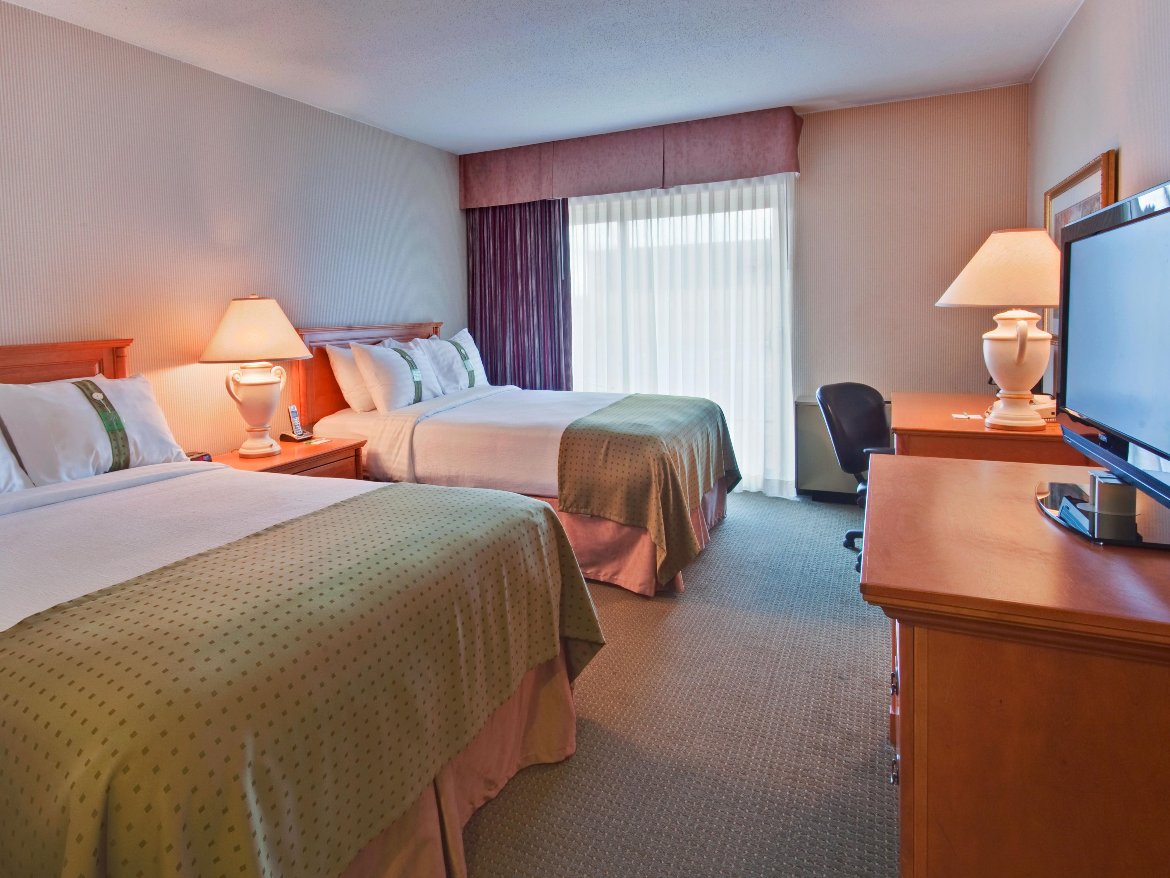 Find comfort in our 2 double bed traditional rooms.