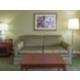 Sleeper Sofa in sitting area of King Room