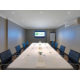 Boardroom with podium, flip charts and and catering