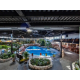 Tropical atrium indoor heated pool with restaurant terrace