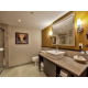 Atrium view suite with glass shower and spacious bathroom