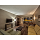 Atrium view suite with hardwoods floors, dining/living area, 2 TVs