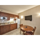 One bedroom suite with kitchenette equipped with stovetop