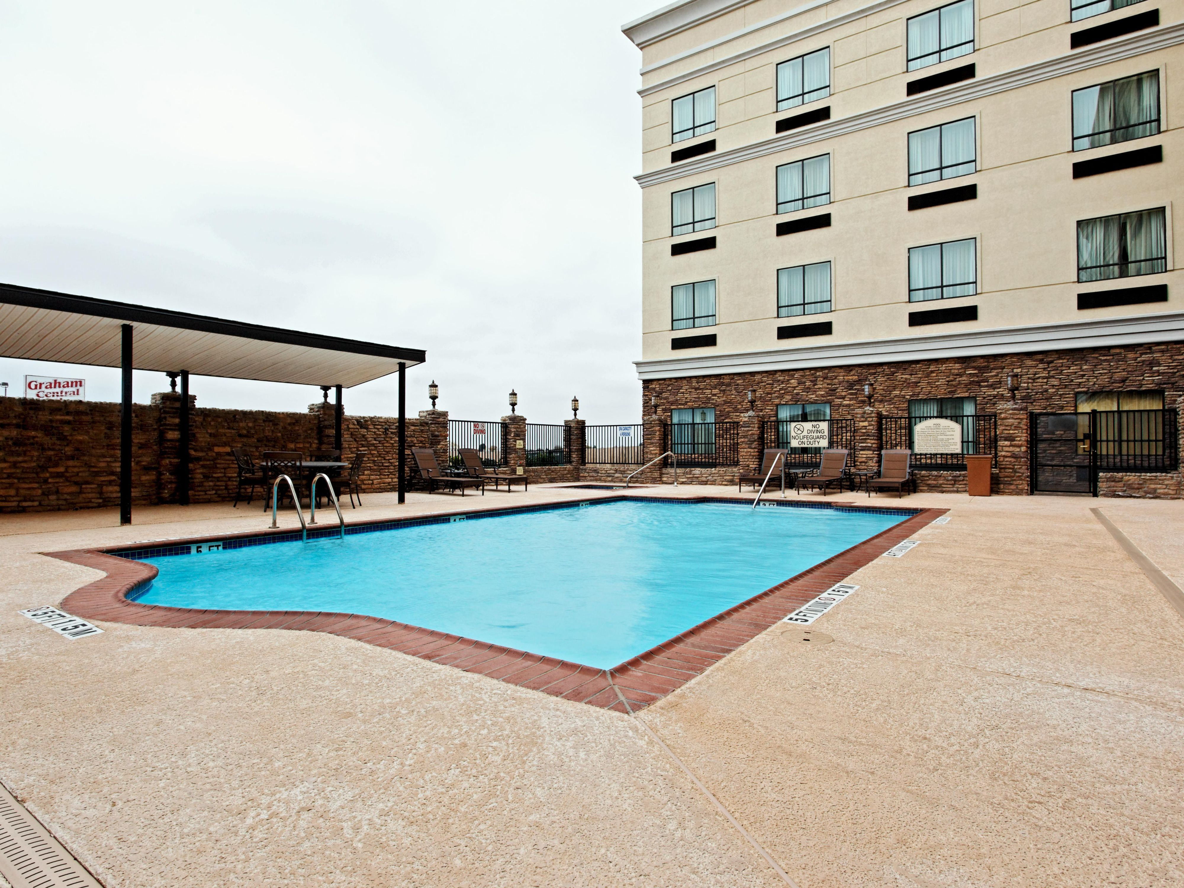 Bring the kids and catch some sun on a summer day by the pool!