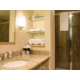 Well appointed bathrooms featuring granite countertops and showers