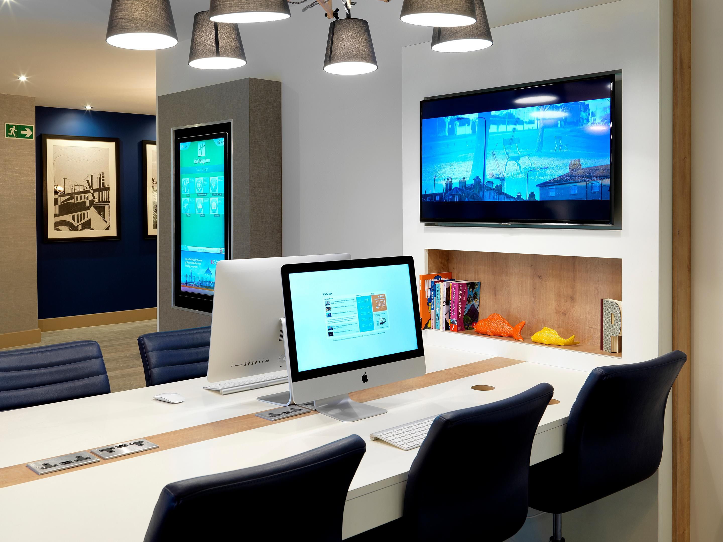 Make use of our media desk with iMacs and free wi-fi