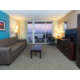 Spacious living area in our suites featuring pull out sofa beds