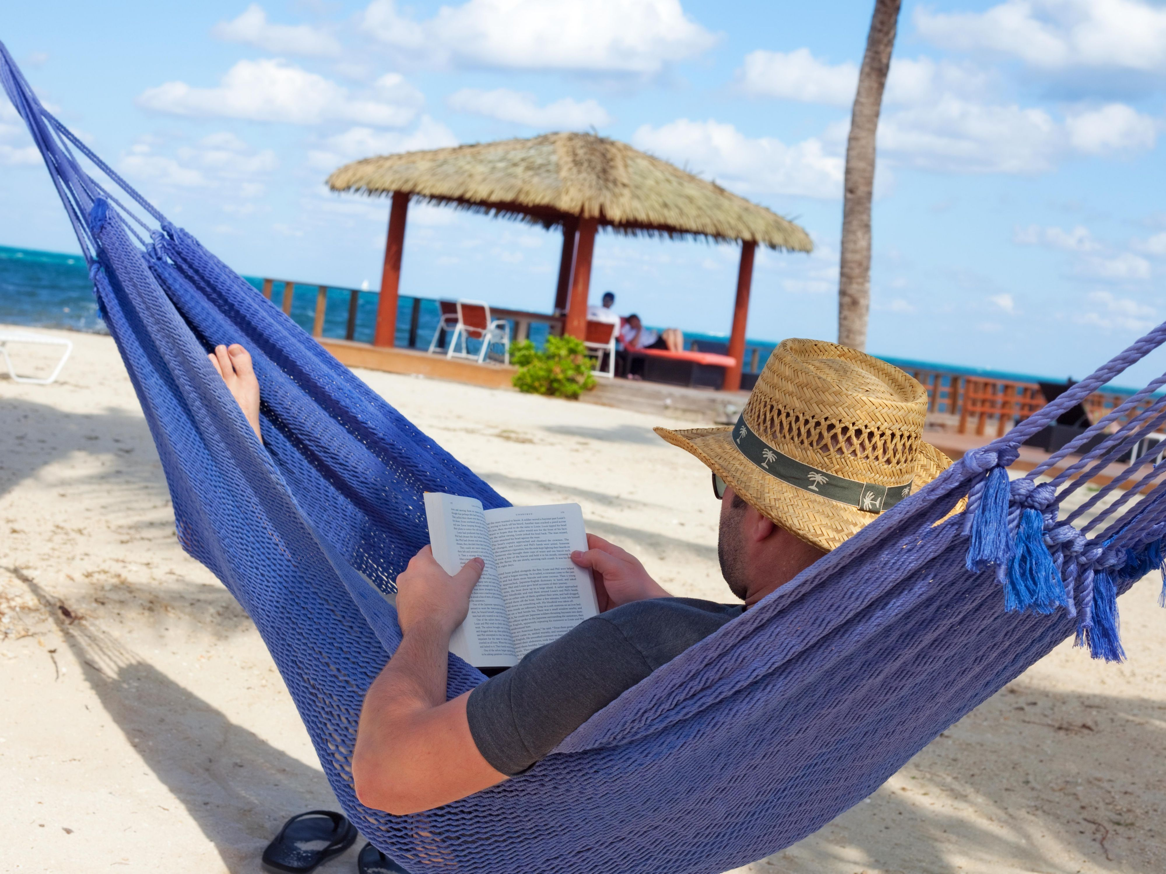 Relax with a book beachside at the Holiday Inn Resort