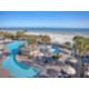 Sparkling Resort Pool Overlooking the Ocean