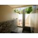 An outdoor shower in a Garden and Beach view villas.