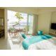 A sea-view from a Family Beach House or a Beach House room type.