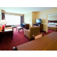 Relax & unwind after a long day of work in our Two-Room Suite!.