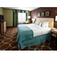 King Bed Guest Room with Microwave and mini refrigerator