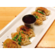 Pork Gyoza with green onion, cilantro, thai chili sauce.