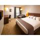 Chambre executive propice à la détente avec canapé-lit