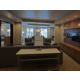 Entry to Executive Suite - Living Room with seating group/dining