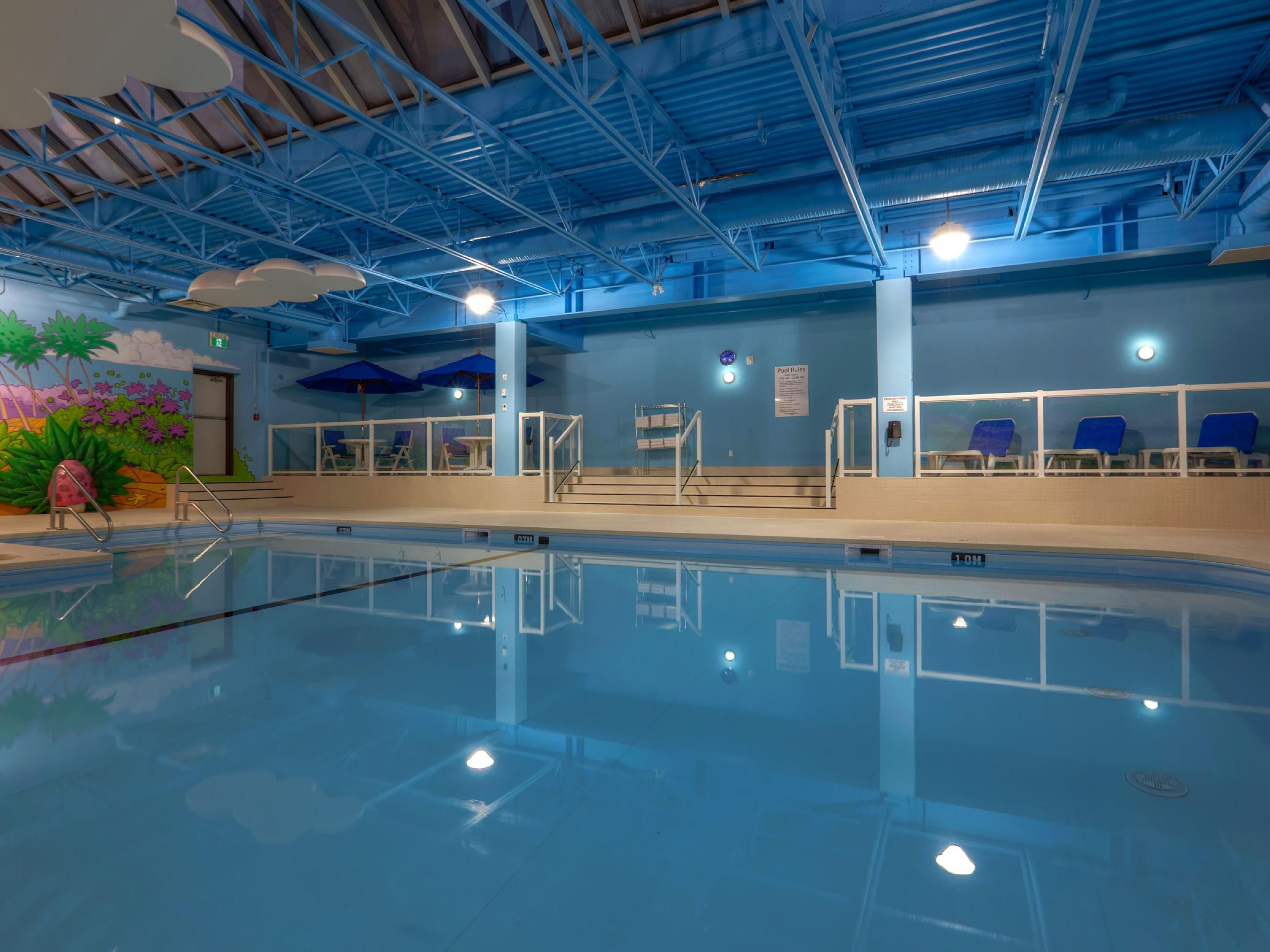 Indoor Heated Swimming Pool Featuring a Skylight and Kids Area