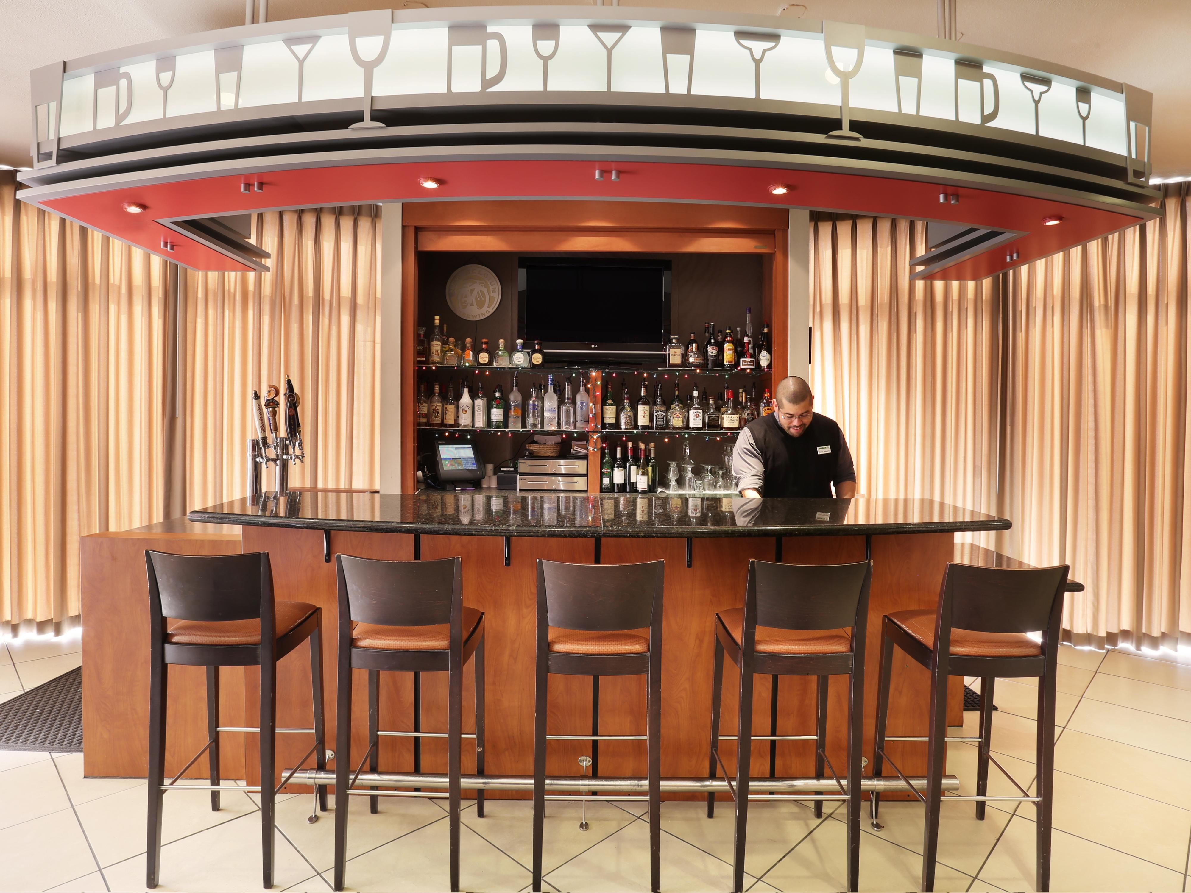 Enjoy a drink before dinner at our Bar and Lounge