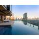 Enjoy the beautiful infinity edge pool with great views of Bangkok