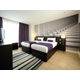 Twin bed guest rooms at Hotel Indigo