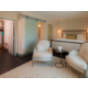 Governor's Suite with King bed, soaking tub, wet bar, living room.