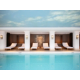 Large heated indoor swimming pool and lounge area