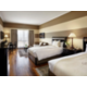 Luxurious Twin Club Guest Room with hardwood floors