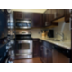 King Feature Suite Kitchen with oven, washer, dryer, refrigerator