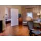 King Feature Suite Living Room hardwood floors, brick/plaster wall