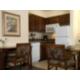 Kitchen with stove, microwave, fridge, & dishwasher.