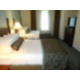Comfy double beds, secluded from the living area and suite entry
