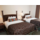 One or Two Bedroom Suite with two double beds in separate bedroom.