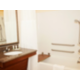 ADA guest bathroom featuring tub with removable bench.
