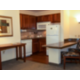 Furnished kitchen with full fridge, stovetop, and dishwasher.