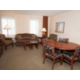 King One Bedroom Suite with expanded living area and dining table.