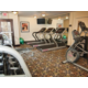 Fitness center featuring treadmills, bike, free weights and more.